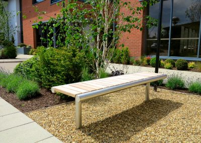 Shoreline SL006 bench, made from Iroko hardwood and 316 stainless steel
