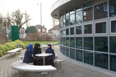 benchmark design limited CL007 stainless steel table and stool, used in school and as street furniture