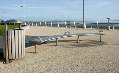 Shoreline SL008 bench and SL052 litterbin. Made from Iroko timber and 316 stainless steel. From our Shoreline street furniture range