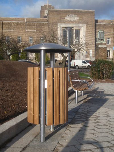 benchmark design Shoreline SL052 litterbin, made from Iroko and stainless steel. From our street furniture range