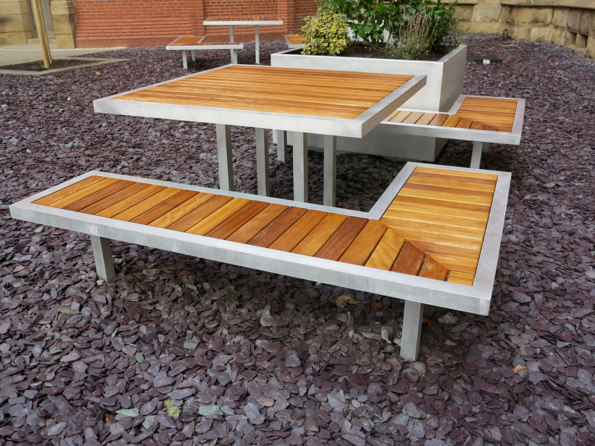 benchmark street furniture campus range. Iroko and aluminium benches
