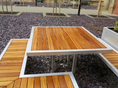 Campus street furniture table. Aluminium and Iroko hard wood table