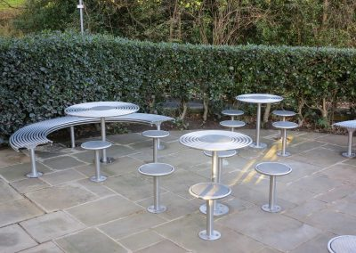 benchmark design street furniture - Circular stools bench and table from 316 stainless steel