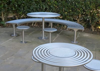 benchmark design street furniture - Circular table and curved bench
