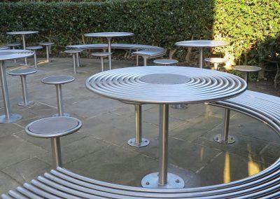 benchmark design street furniture - stainless steel Circular stools.jpg