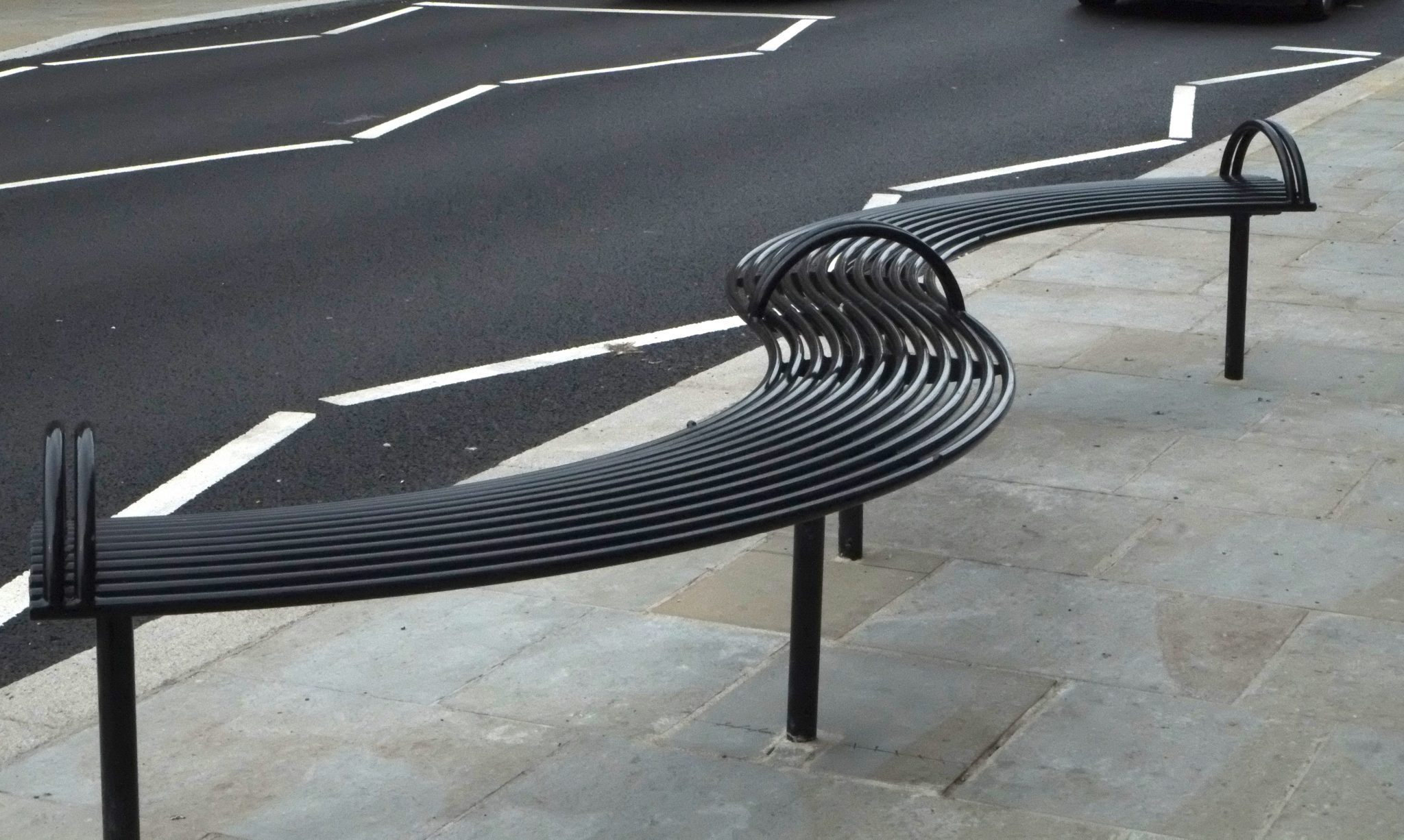 Curved steel bench from benchmark street furniture