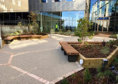 Hardwood benches for Exeter university from Benchmark street furniture